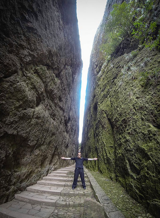 Jeb Corliss standing in the crack at Mount Jianglang *Photographer:* Courtesy of Jeb Corliss